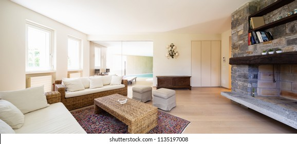 Modern living room with wicker furniture in a design villa. Nobody inside