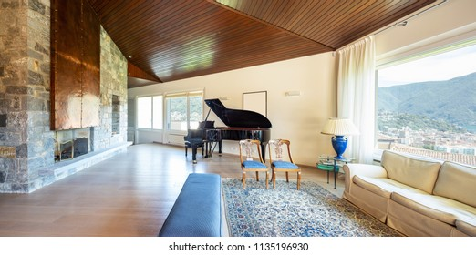 Modern living room with wooden ceiling in the villa. Nobody inside