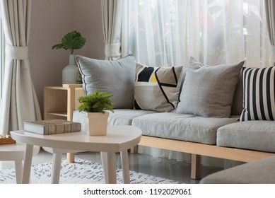 modern living room with wooden sofa and gray pillows, interior decoration design concept