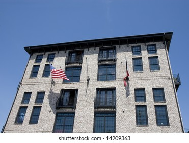 Modern loft building in a classic architecture style with american flags out front