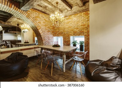 Modern Loft Cafe with brick wall interior design. Vintage luxury style decor