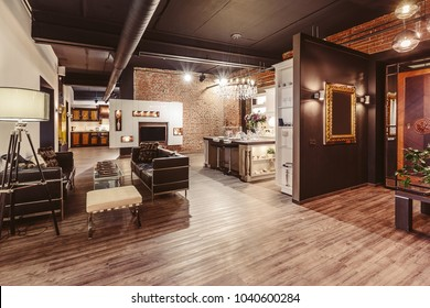 Modern loft flat, living room studio with luxury candelabra lamp, kitchen and brick walls