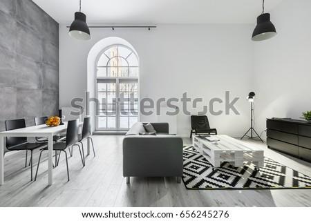 Modern loft interior sofa dining table stockfoto jetzt bearbeiten