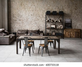 Modern loft living room with high ceiling, sofa, empty brown brick wall, concrete floor, wooden cabinet, design accessories in the steel stack, dining table with chairs. Mock up interior photo