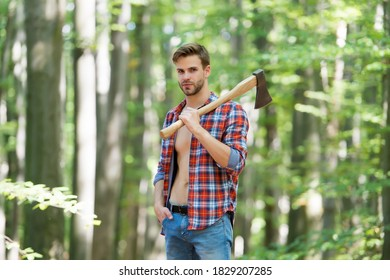 Modern logger. ranch man carry axe. sexy guy wear unbuttoned shirt in forest. male power and energy. firewood at the campsite. camping and hiking. outdoor activity. strong man with ax. woodcutter.