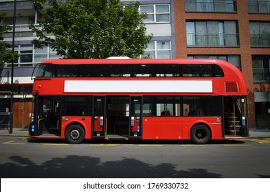 A modern London double-decker bus, spotted from the left side, with its doors open.