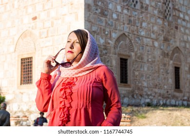 Modern Lookalike Muslim Woman With Scarf and Sunglasses Posing in Front of the Mosque