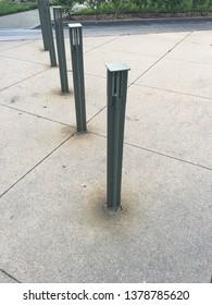 Modern looking metal traffic blockers.