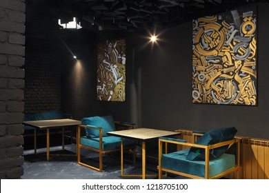 Modern lounge bar interior.Dark tone.Dark cyan sofa and chairs.Golden laterns in form of tubes.