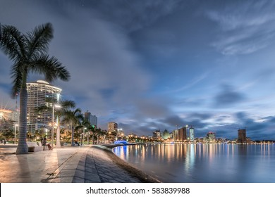 the modern Luanda's bay front walk at dusk
