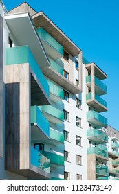 Modern, luxury apartment building with glass balconies.