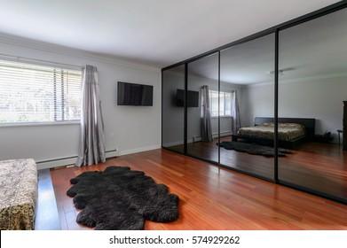 Modern luxury bedroom with a large mirror closet. Interior design.