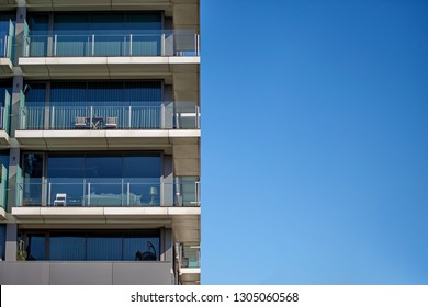 Modern Luxury Building with Glass Balconies over Blue Sky