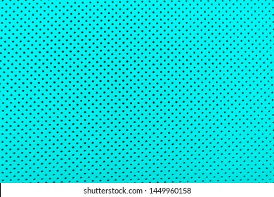 Modern luxury Car blue leather interior.  Part of perforated leather car seat details. Blue Perforated leather texture background. Texture, artificial leather with stitching.