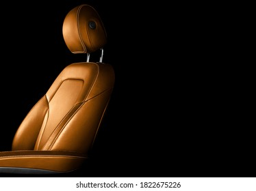 Modern luxury car brown leather interior. Part of orange leather car seat details with white stitching. Interior of prestige car. Comfortable perforated leather seats. Perforated leather.  - Shutterstock ID 1822675226