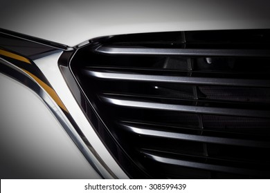 Modern luxury car close-up of grille. Background, concept of expensive, sports auto detailing