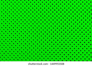 Modern luxury Car green leather interior.  Part of perforated leather car seat details. Green Perforated leather texture background. Texture, artificial leather with stitching.