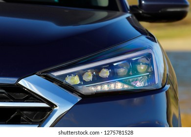 Modern and luxury car headlights. Exterior detail.