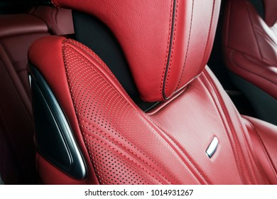 Modern Luxury car inside. Interior of prestige modern car. Comfortable leather red seats. Red perforated leather. Modern car interior details