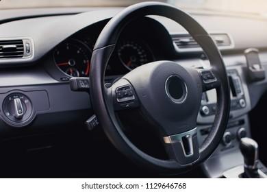 Modern luxury car Interior - steering wheel, shift lever and dashboard. Car interior luxury inside. Steering wheel, dashboard, speedometer, display.