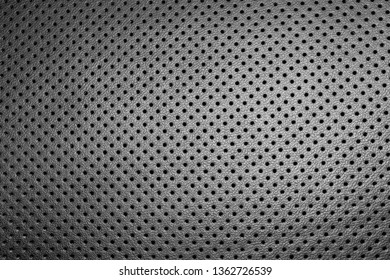 Modern luxury Car leather interior.  Part of perforated car seat details. Perforated leather texture background. Texture, artificial leather with stitching. Perforated leather seats