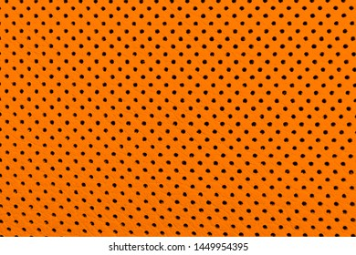 Modern luxury Car orange leather interior.  Part of perforated leather car seat details. Brown Perforated leather texture background. Texture, artificial leather with stitching.
