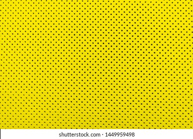 Modern luxury Car yellow leather interior.  Part of perforated leather car seat details. Yellow Perforated leather texture background. Texture, artificial leather with stitching.