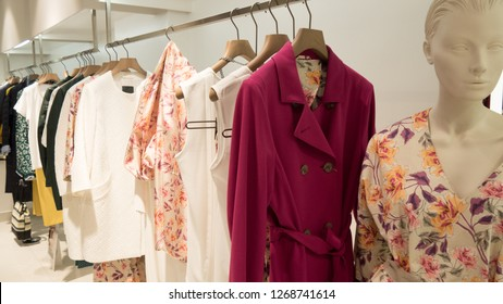 Modern, luxury and fashionable woman clothes shop.