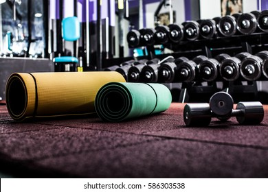 Modern luxury fitness center city. Closeup of dumbbells in gym.