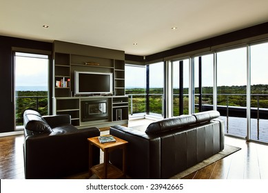 A modern luxury home interior living area with a beautiful view.