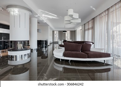 Modern luxury interior in minimalistic style: living room and kitchen in daylight