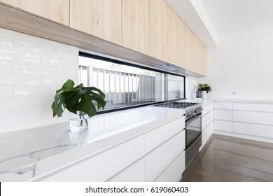 Modern luxury kitchen with window splashback