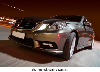 Modern luxury sedan driving fast