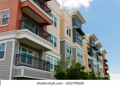 Modern luxury urban apartment building exterior with blue sky.