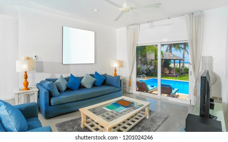 Modern luxury villa interior design of living room overlooking the pool and calm beach.