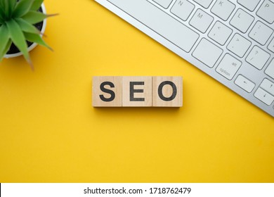 Modern marketing buzzword SEO - Search engine optimisation. Top view on wooden table with blocks. Top view. Close up.