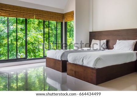 Modern twin bed White Modern Master Bedroom With Twin Beds And Wide Glass Windows The Design To Give Scenic Yliving Modern Master Bedroom Twin Beds Wide Stock Photo edit Now
