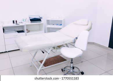 Modern medical examination couch in doctor's office