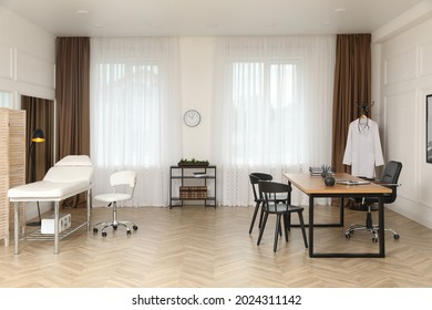 Modern medical office interior with doctor's workplace and examination table