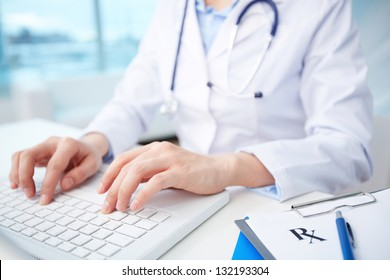 Modern medical person inputting diagnosis into an online data base