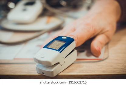 Modern medical technology for measuring pulse called pulse oximeter on the finger of a woman. Hospital tools and equipment