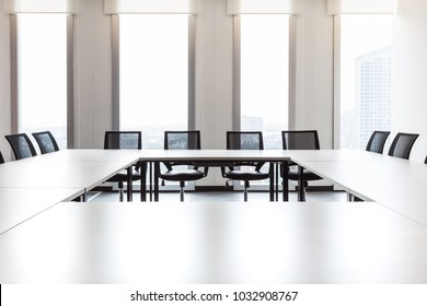 Modern meeting room with large windows, outside building, city, tower view, soft focus