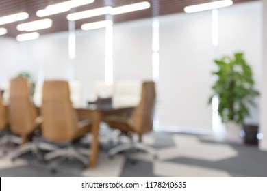 Modern meeting room with large windows, soft focus