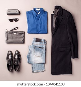 modern mens wear set against gray background