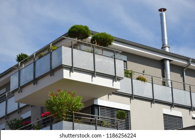 Modern Metal Balcony in Front of a modern residential Building