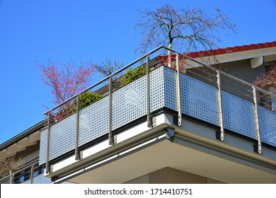 Modern Metal Balcony with high grade Privacy Protection Screen and metal Hand Rail at a residential Building