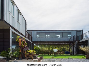 Modern metal building made from shipping containers and blue sky background .