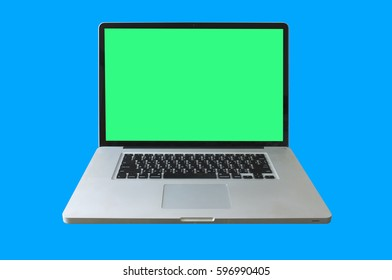 Modern metal laptop or notebook computer on a blue background. Green area for retouch