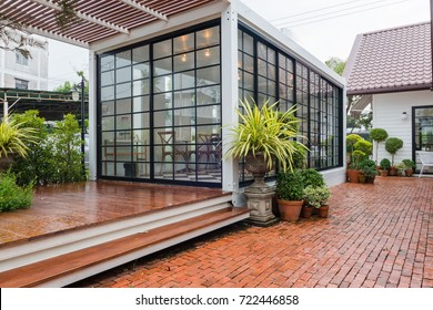 Modern metal White building made from shipping containers .