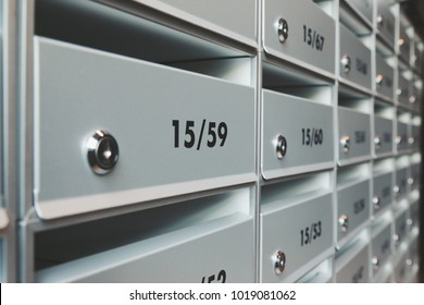 modern metallic mail box mail room in share common area space of condominium apartment flat unit mansion
